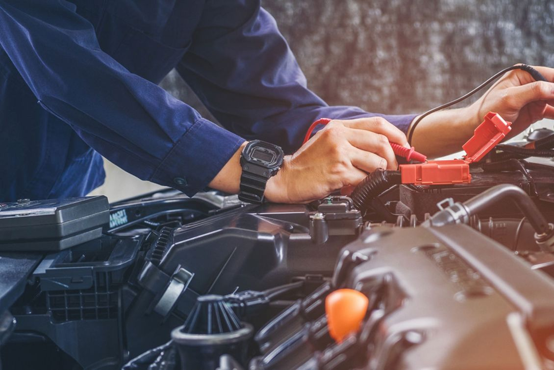 Mechanic making repairs to a car engine